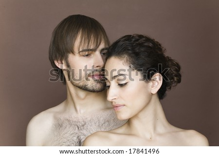 Man and woman in studio - stock photo