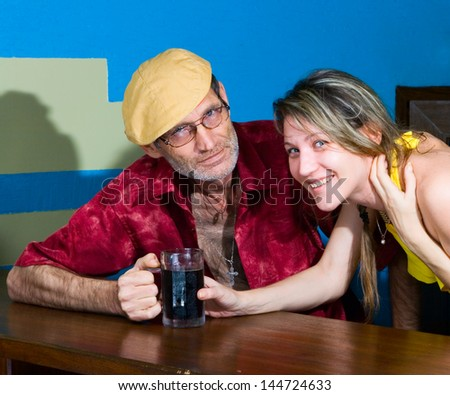 Man and woman in the bar - stock photo