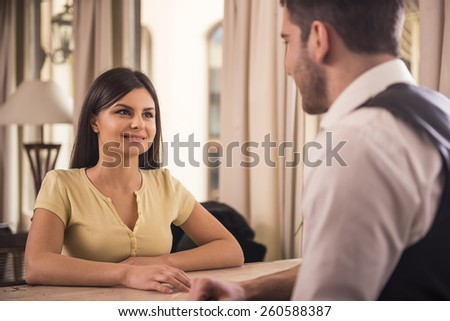 Man and woman is spending time in cafes. - stock photo