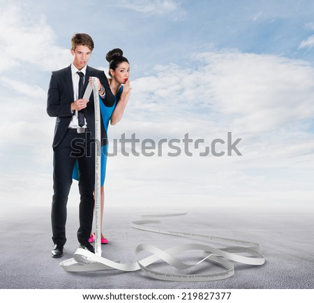 Man and woman looking at a long receipt - stock photo