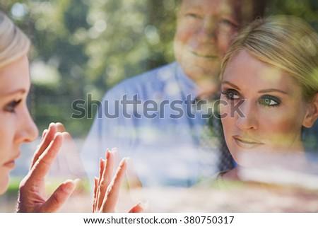 Man and woman looking at reflections - stock photo
