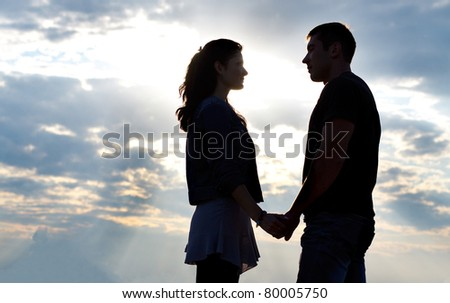 Man and woman silhouette - stock photo