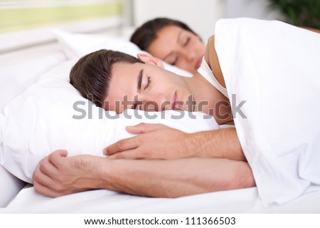 Man and woman sleeping - stock photo