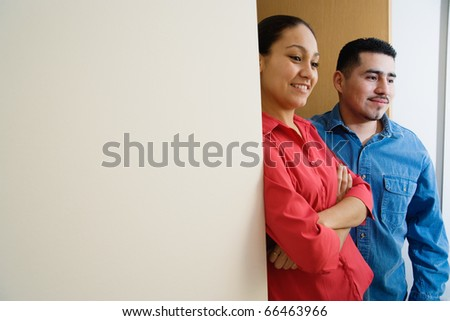 Man and woman standing in doorway - stock photo
