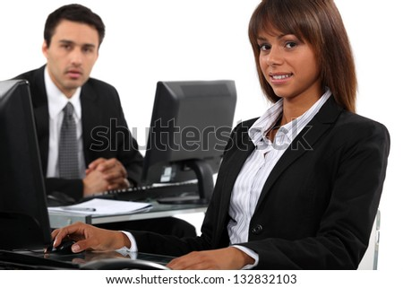 Man and woman taking a break from working to pose for the camera - stock photo