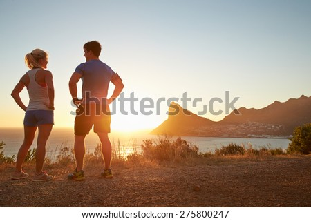 Man and woman talking after jogging - stock photo
