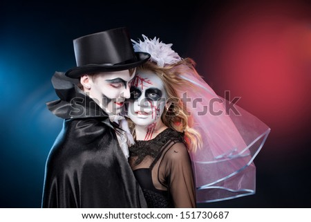 man and woman  wearing  as  vampire and dead bride. Halloween - stock photo
