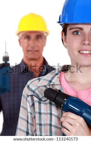 Man and woman with drills - stock photo