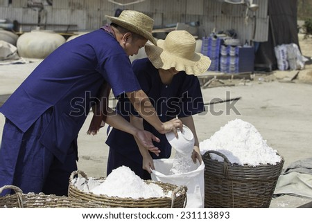man and woman worker at salt field, Thailand - stock photo