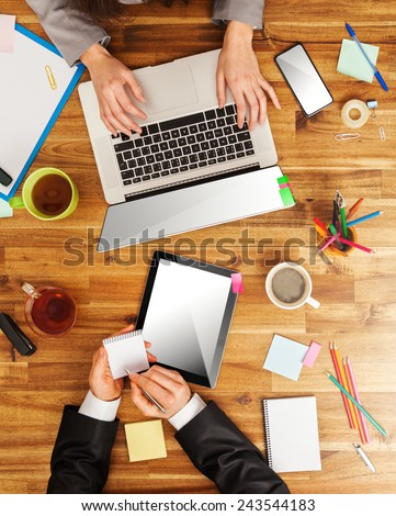 Man and woman working on laptops. Shot from above view - stock photo