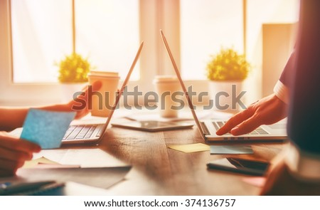 man and woman working on their computers.  - stock photo
