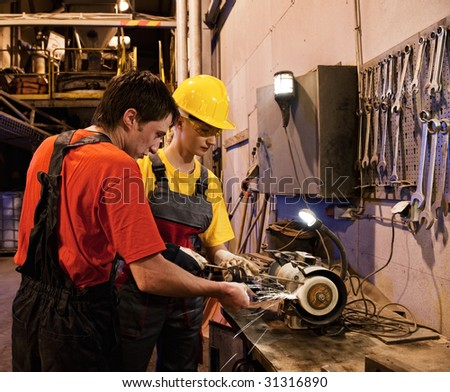 Man and woman working together - stock photo