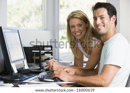 man and women on computer at home - stock photo