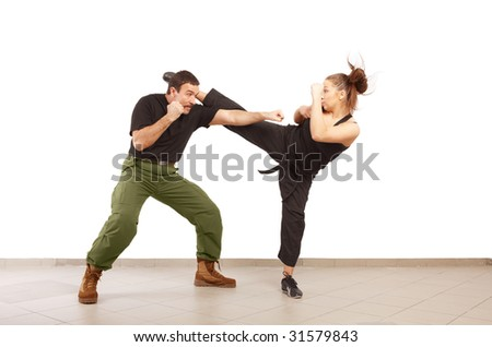 Man and young woman fighting together - stock photo