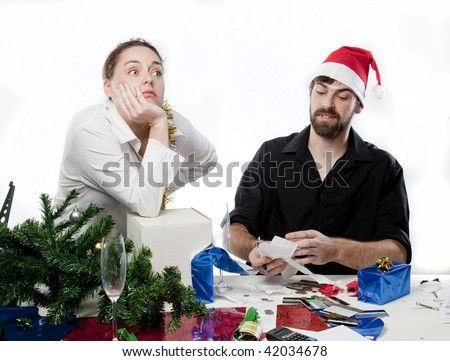 Man arguing with his wife about her Christmas spending - stock photo