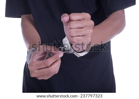 Man arrested with handcuff both of hand isolate white background - stock photo