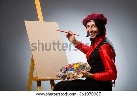 Man artist in art concept - stock photo