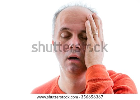 Man asking himself what I have done, deplored for his actions holding his side of head with guilt - stock photo