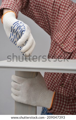 Man assembling the wooden chest - stock photo