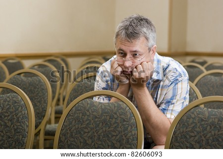 Man at  a boring conference - stock photo