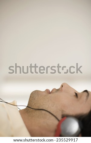 Man at Home Listening to Music - stock photo