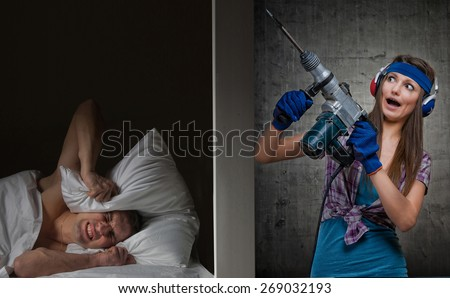 Man at night can't fall asleep because of the noisy neighbor - stock photo