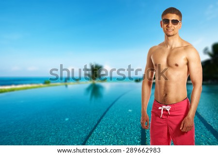 Man at swimming pool in the tropical hotel. Collage. - stock photo