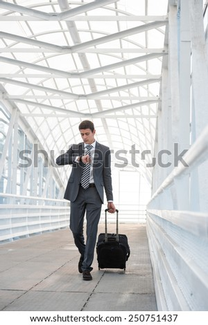 Man at the Airport with Suitcase - stock photo