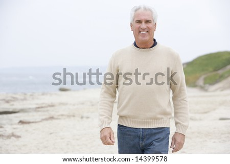 Man at the beach smiling - stock photo