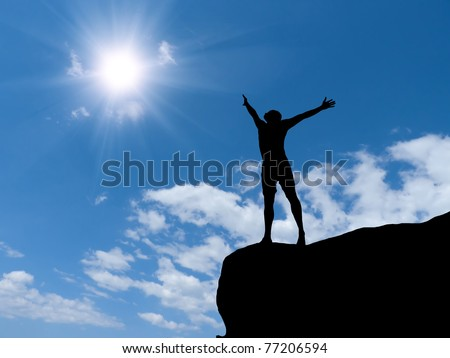 man at the top of the mountain against the sky - stock photo