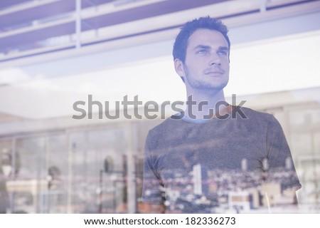 Man at window - stock photo