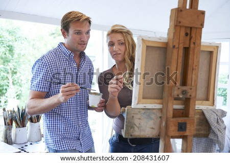Man Attending Painting Class - stock photo