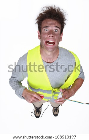 Man being electrocuted - stock photo