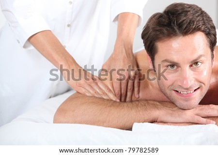 Man being given a massage. - stock photo