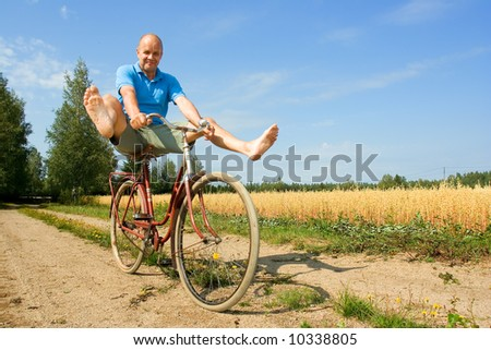 Man bicycling - stock photo