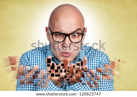 Man blowing his hand - stock photo