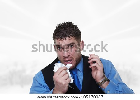 man blowing his nose will a bad cold - stock photo