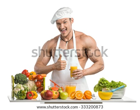 Man bodybuilder in white toque blanche and cook protective apron, concoction freshly squeezed orange juice  , on whie background, isolated - stock photo