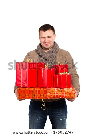Man bought a lot of gifts for the woman loved. Very many gifts in the hands of men. Gifts in red packing for a holiday. Gained a lot of shopping on sale. Surprised that so many bought. Spent money. - stock photo