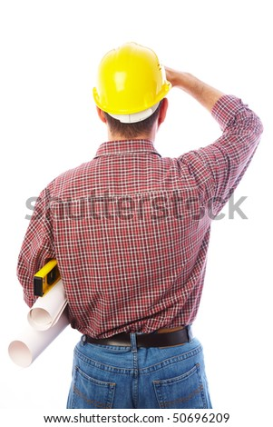 man-builder is back and looking forward shielding hand - stock photo