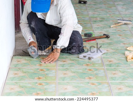 Man building contractor Floor tile installation, for  Home Building - stock photo