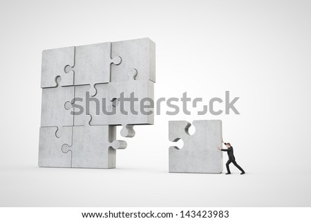 man building puzzle - stock photo