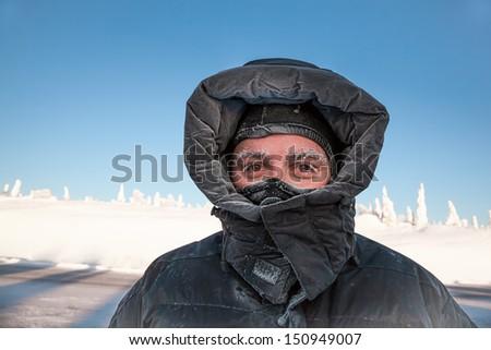 Man bundled in winter coat in Alaska - stock photo