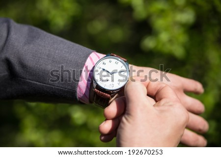 Man business modern in wristwatch - stock photo