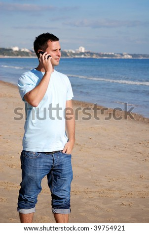 Man calling home from abroad - stock photo