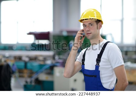 man calling in factory - stock photo