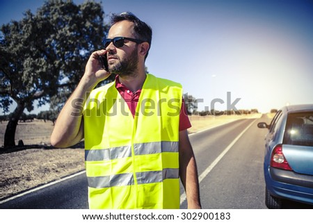 Man calling to insurance company after a car breakdown. - stock photo