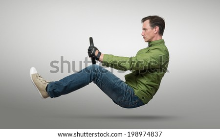 Man car driver with a wheel - stock photo