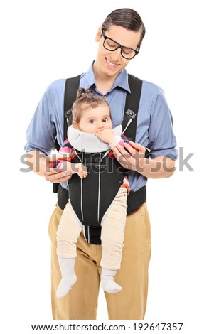 Man carrying a cute baby girl isolated on white background - stock photo