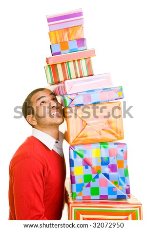 Man carrying a tall stack of gifts - stock photo